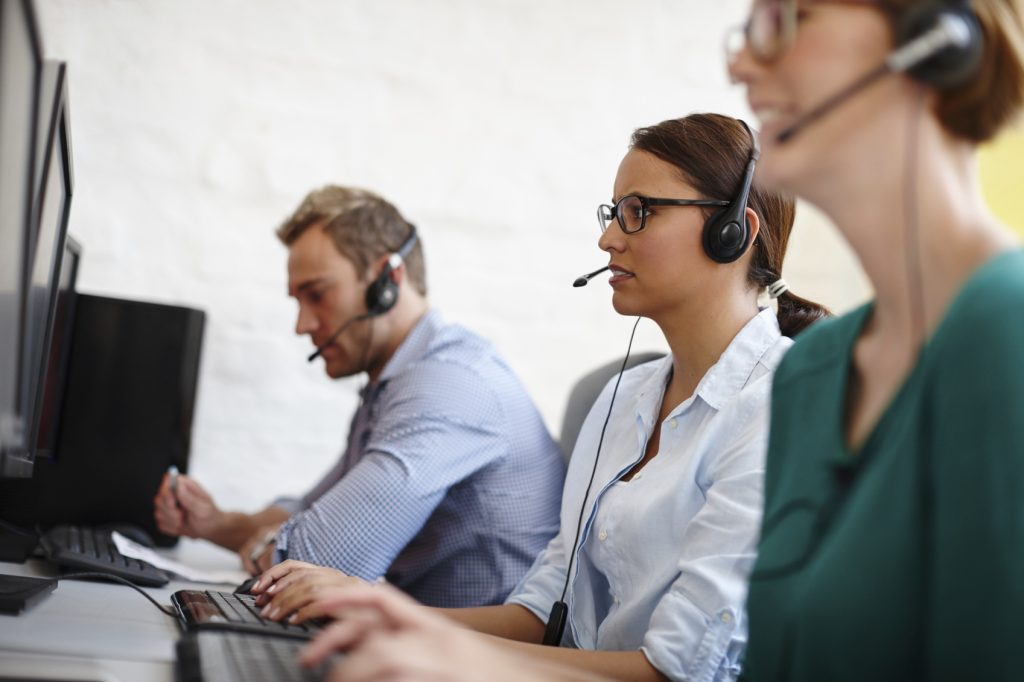 A group of customer service representatives taking calls at their computershttp://195.154.178.81/DATA/istock_collage/a4/shoots/785164.jpg